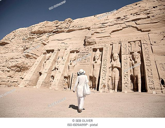 Mature woman tourist at Abu Simbel, The Rock Temple in Nubia, Southern Egypt commemorating Pharaoh Ramesses II and his wife Queen Nefertari, Egypt