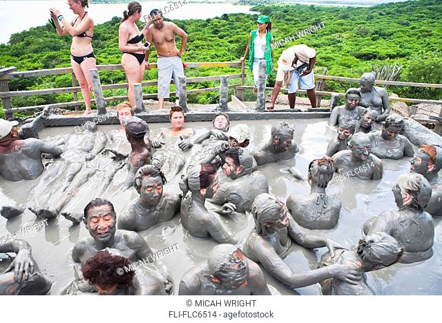 Tourists getting skin enhancing treatment at El Totumo Mud Volcano, Catagena, Colombia