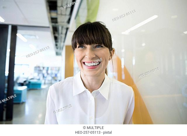 Portrait smiling businesswoman looking away
