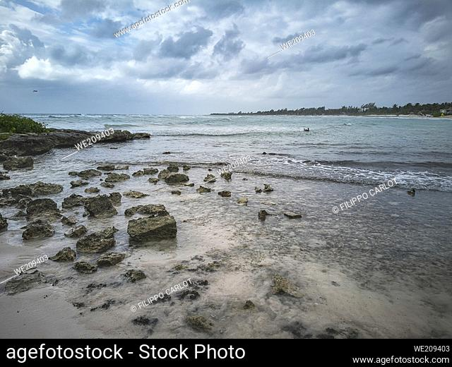 View of the natural beach of Xpu-Ha in the Mayan Riviera in Mexico under a cloudy winter sky