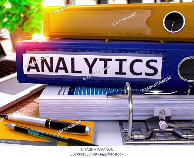 Analytics - Blue Ring Binder on Office Desktop with Office Supplies and Modern Laptop. Analytics Business Concept on Blurred Background