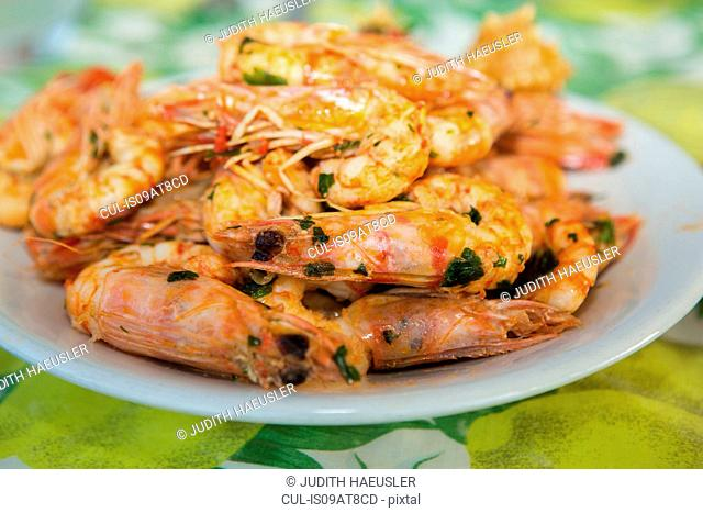 Plate of fried prawns and herbs