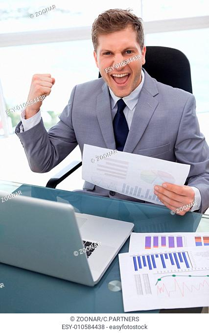 Businessman celebrating market research results