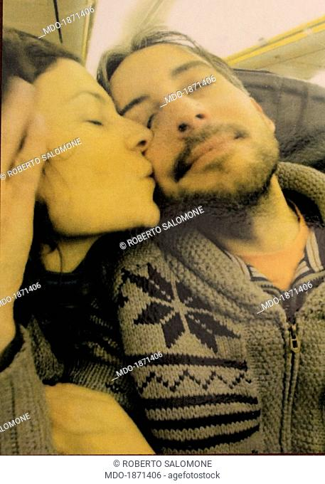 Paola Volpe cuddling her partner and policeman Fabio Graziano, who is into a coma because of an accident caused by a hit-and-run driver