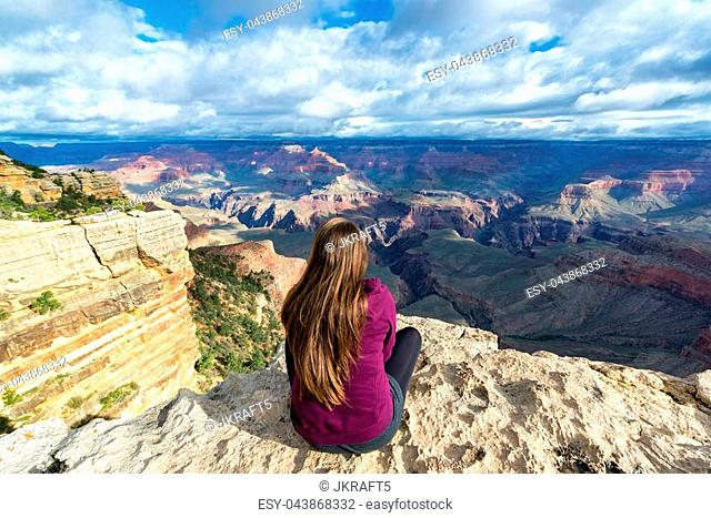 Beautiful woman looking out at the Grand Canyon from the South Rim