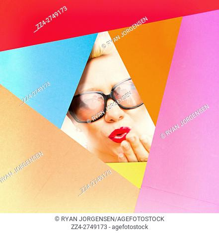 Creative retro fashion girl with surprise expression in revival sunglasses in front of makeup color schemes board. Cardboard pin up