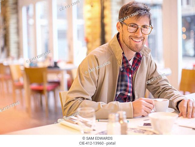 Man enjoying cup of coffee in cafe