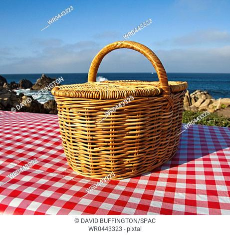 Picnic Basket on Wooden Picnic Table