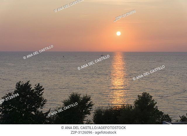 Sunset over Adriatic sea Plava Laguna beach Tisno Croatia