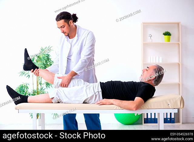 The old injured man visiting young doctor