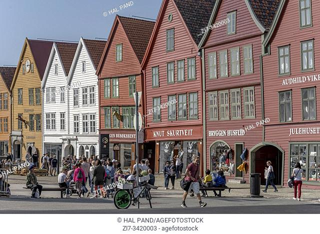 BERGEN, NORWAY - July 19 2019: cityscape with picturesque houses facades on Briggen neighborhood quay, shot under bright summer light on july 19, 2019 at Bergen