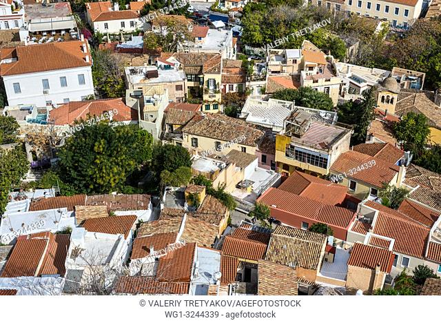 View of Athens from Acropolis with mass of houses, buildings, apartments, rooftops in the city center of Greek capital, Greece