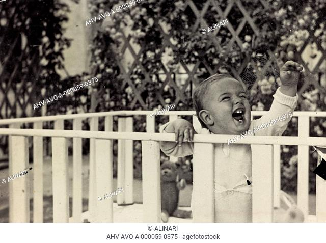 Smiling baby in the box, shot 1934