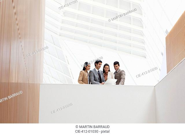 Business people reviewing paperwork in modern building