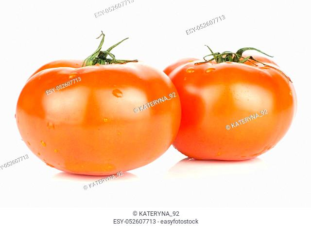 Two red tomato with vine ends isolated on white background fresh