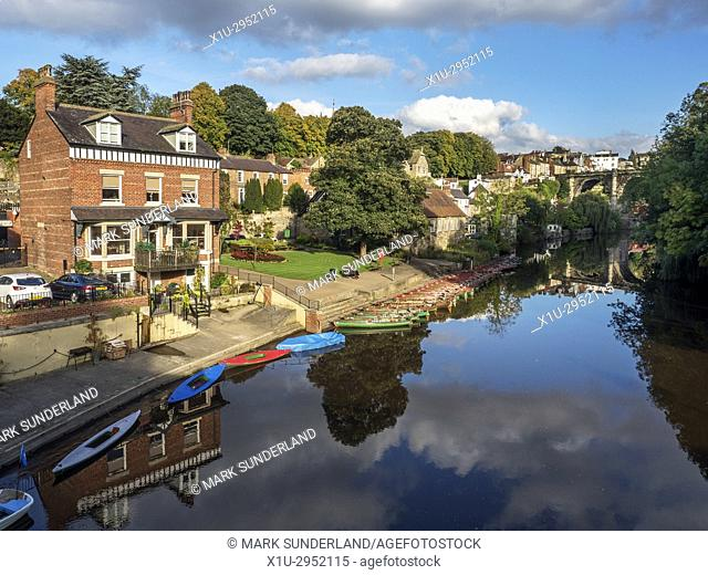 Reflections and Rowing Boats in the River Nidd from Low Brodge at Knaresborough North Yorkshire England