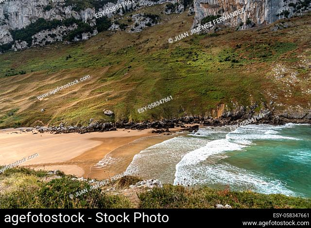 Scenic view of the beach with turquoise water from above. Sonabia beach, Cantabria, Spain