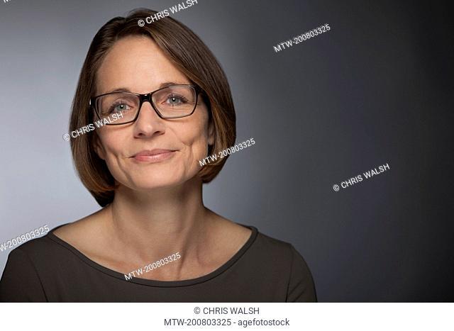 Woman portrait smiling glasses mature middle aged