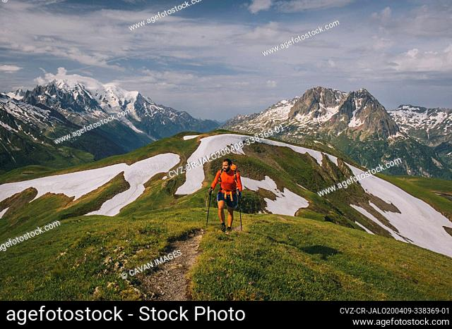 Young male hikes in the French Alps with Mont Blanc as a backdrop