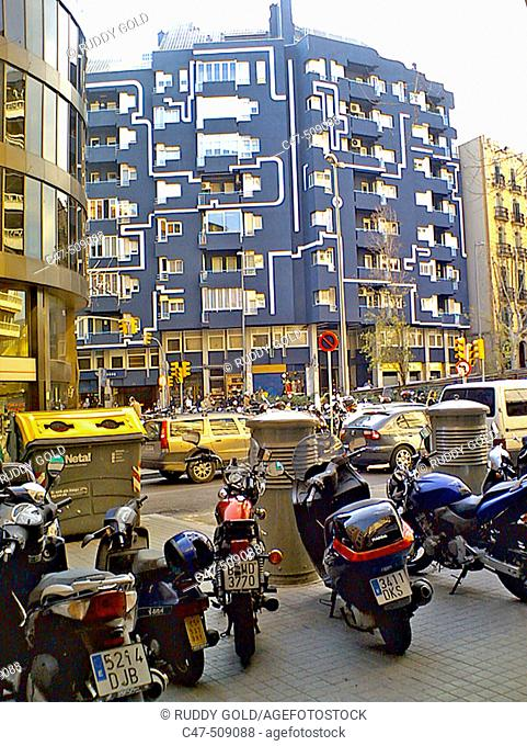 Motorbikes and recycling containers. Barcelona, Spain