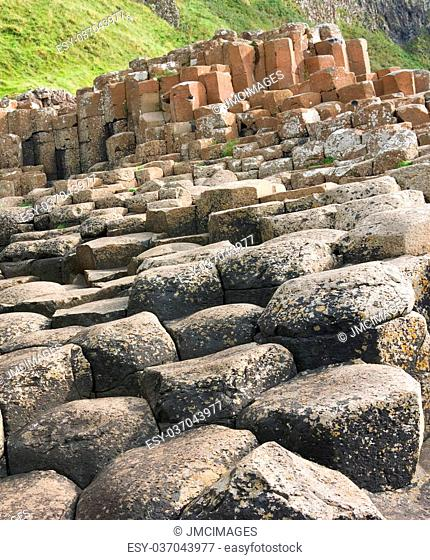 Hexagonal basalt columns, a natural volcanic rock formation at the Giant's Causeway, County Antrim, Northern Ireland