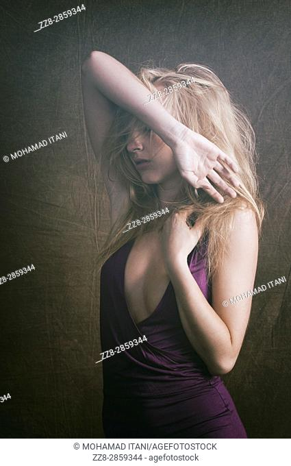 Slim blond woman hands on head in pain