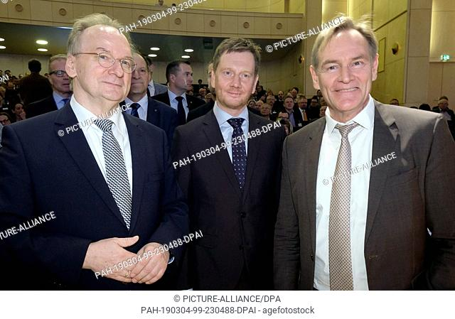 04 March 2019, Saxony, Böhlen: Reiner Haseloff (CDU/ l-r), Prime Minister of Saxony-Anhalt, Saxony's Prime Minister Michael Kretschmer (CDU) and Leipzig's Lord...