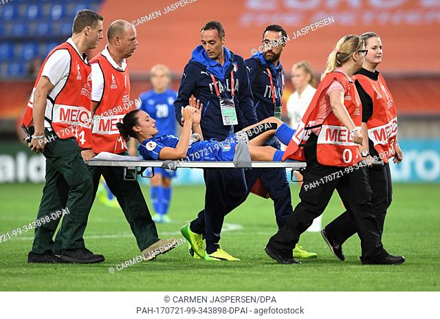 Ilaria Mauro from Italy is carried off the pitch during the women's European Soccer Championships group B match between Germany and Italy at the Koning Willem...