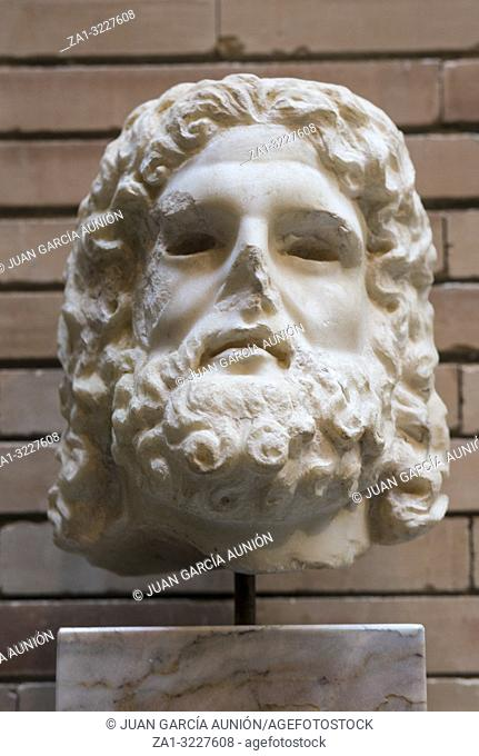 Merida, Spain - December 20th, 2017: Statue head depicting Serapis God. National Museum of Roman Art in Merida, Spain
