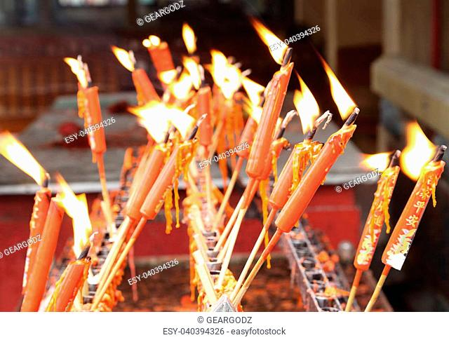 lucky red chinese candles in temple