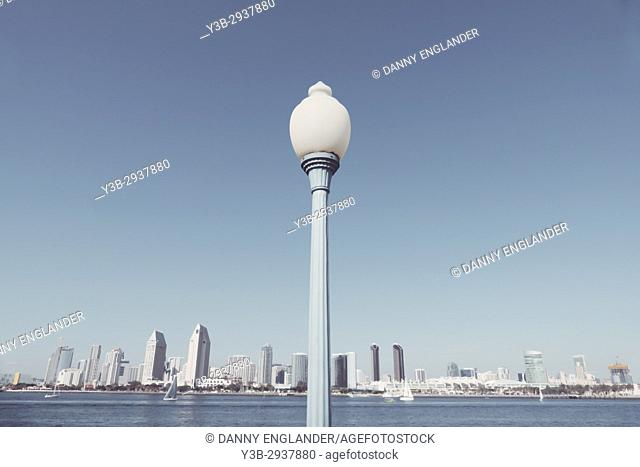 Historic lamp post with a panoramic view of downtoan San Diego, California, in the background