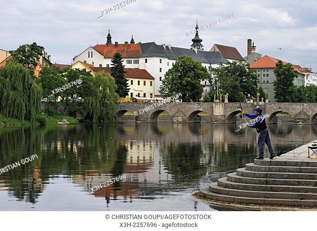 angler beside the old Stone Bridge of Pisek over the Otava river, South Bohemian Region, Czech Republic, Europe