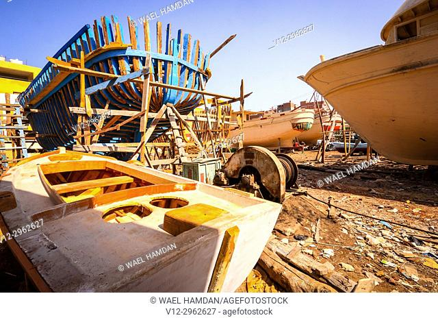 Painting work on new wooden boats on a dry dock, El-Burullos, Kafr El-Sheikh, Egypt, Africa