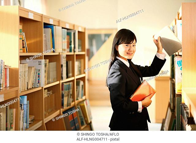 Japanese high-school student in the school library