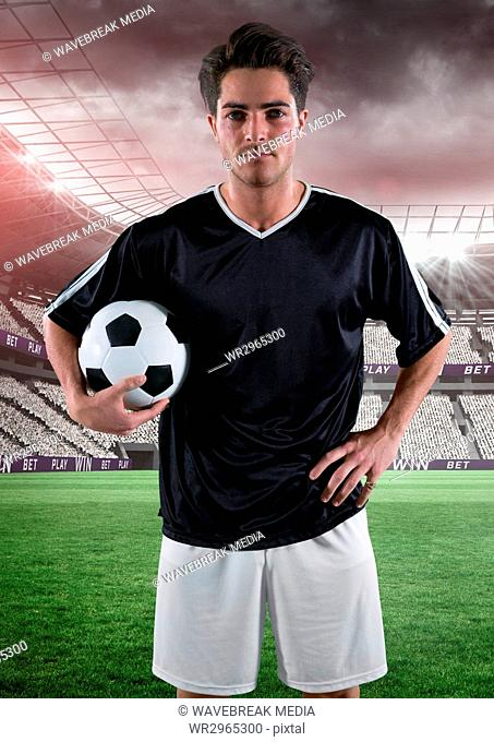 soccer player with the ball on his arm in the field