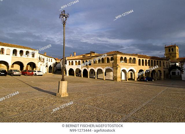 Village of Garrovillas, Plaza Major, covered footpath and cobblestone pavement, cathedral, Extremadura, Spain