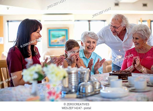 Grandparents celebrating a birthday with their granddaughter