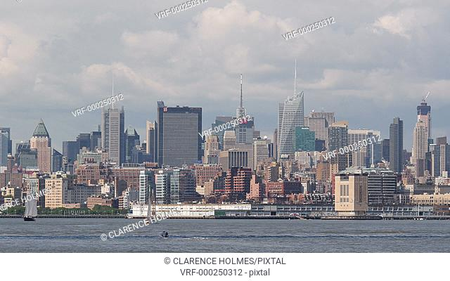 Panning view of the midtown Manhattan skyline, including the Empire State Building, on a sunny afternoon in New York City