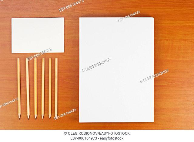 Corporate ID set on wood background for presentations and portfolios