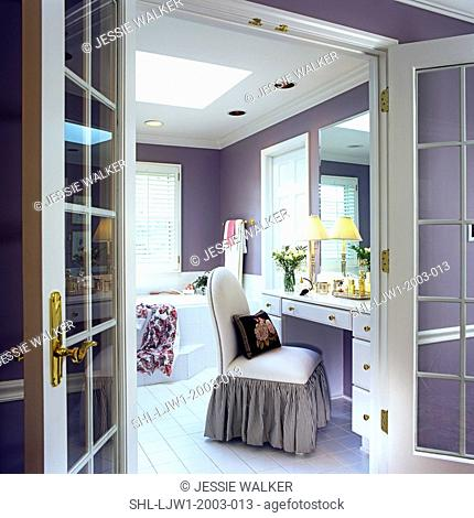 BATHROOMS: White French doors open to dressing table on right, slipper chair with white and black striped skirt, Deep purple painted walls