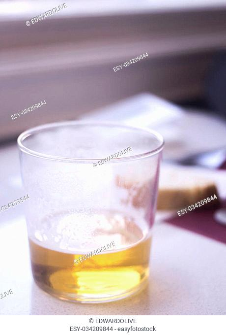 Half empty lager beer glass in restaurant bar photo