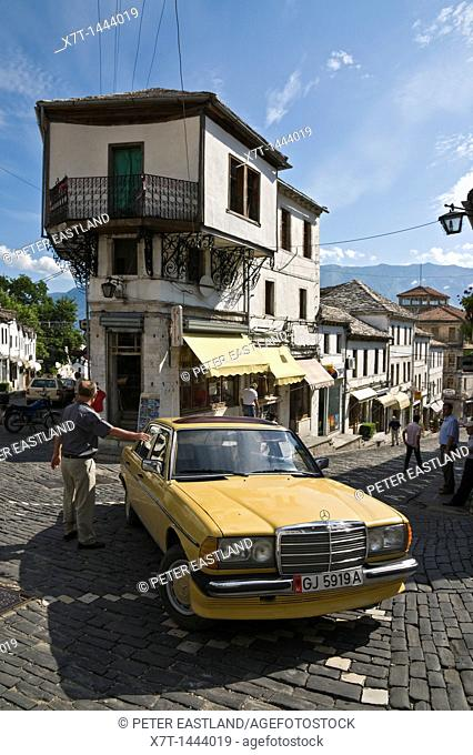 In the centre of the bazaar area of Gjirokasrta in southern Albania with its old ottoman influenced houses and ubiquitous, old, Mercedes