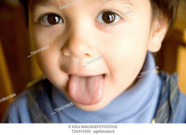 2 year old boy sticking out tongue, Flagstaff, Arizona USA