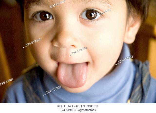 2 year old boy sticking out tongue, Flagstaff, Arizona USA