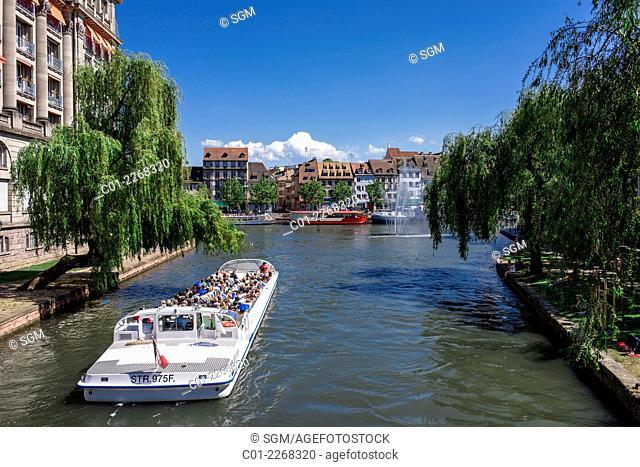 Tour boat on Ill river and Quai des Pêcheurs fishermen quay Strasbourg Alsace France
