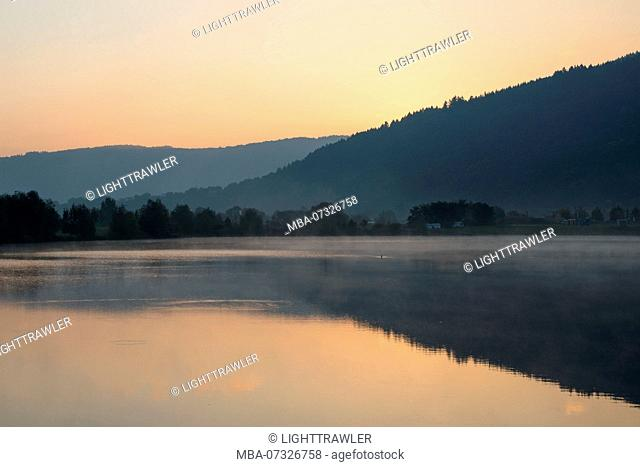 View of a lake in the early morning just before sunrise