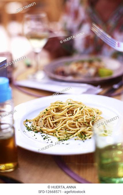 Dinner table with a plate of Spaghetti with bottarga