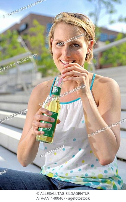 Woman drinking a refreshment