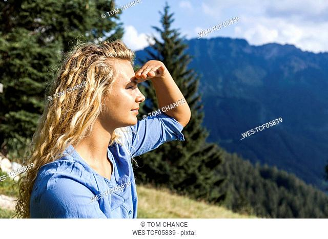 Germany, Bavaria, Oberammergau, young woman on a hiking trip looking at view