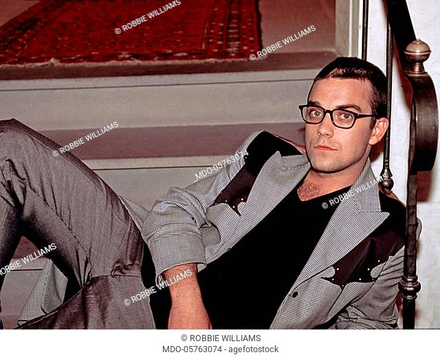 British singer Robbie Williams lying on the steps at the music festival Vota la voce 1997. Arezzo, September 1997